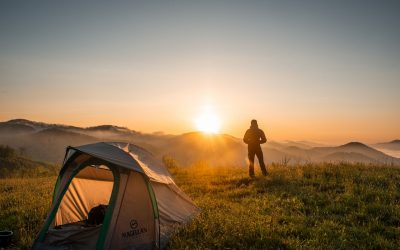 silhouette-of-person-standing-near-camping-tent-2398220